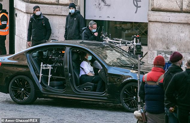 Filming continues: Hayley and Tom were surrounded by crew as they filmed their scenes