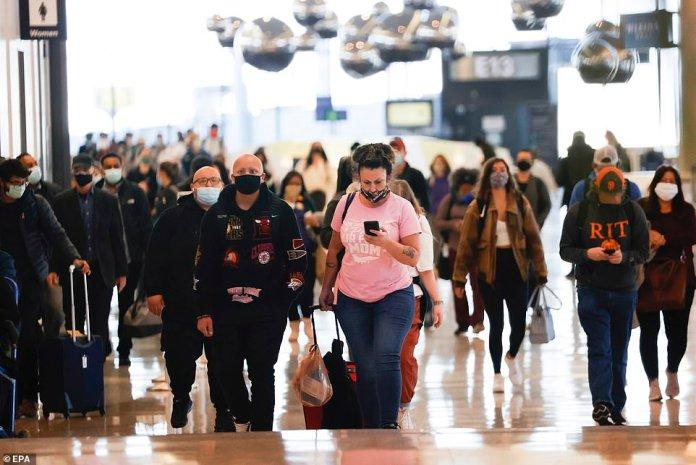 SAN FRANCISCO, CALIFORNIA:Passengers arrive at a United gate at San Francisco International Airport yesterday