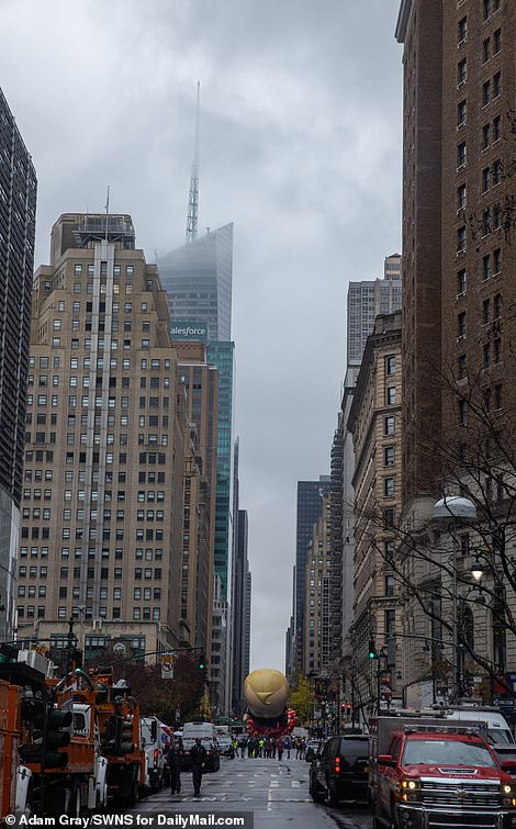 The scene was gloomy and rainy as the 94th annual Macy's Thanksgiving Day parade began