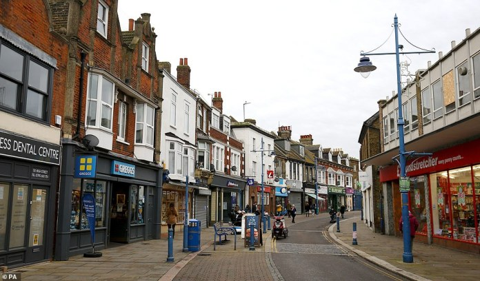 Swale has the highest infection rate in the UK at 541.7 per 100,000, according to the Department of Health. Its high street is pictured above