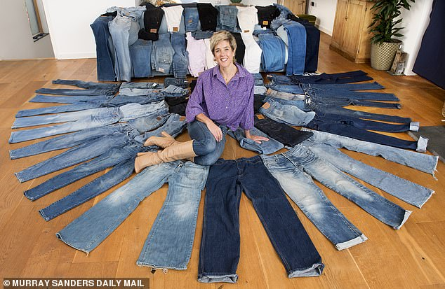 Kato harrison, at home in St Minver, Cornwall with her collection of jeans. She has over 90 pairs of jeans to her name, and thinks she must have spent over £20,000 on them