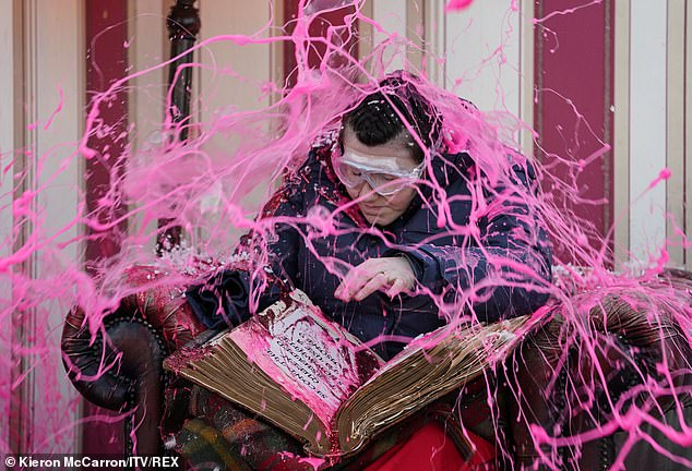 Yikes: The pair had to find missing words or items as part of the task, with Hollie doused in pink goo if they got an answer wrong