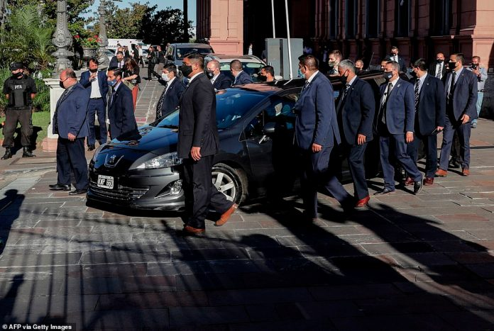 The funeral cortege of late Argentinian football legend Diego Armando Maradona leaves the Casa Rosada government house to the cemetery, in Buenos Aires