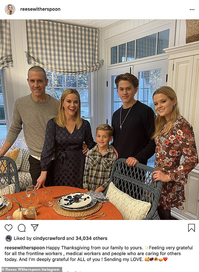 Thanksgiving at home: Reese Witherspoon thanked frontline workers in the COVID-19 fight when she shared a photo of her family's Thanksgiving celebration; she is pictured with husband Jim Toth, their son Tennessee, eight, and her daughter Ava, 21, and son Deacon, 17, that she shares with ex-husband Ryan Phillippe