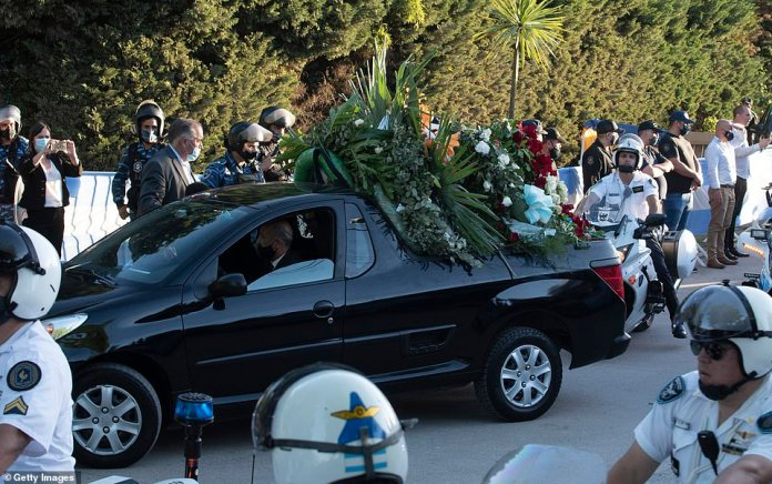 The flower car follows the hearse carrying the body of Argentine football legend Diego Maradona as it enters Jardin Bellavista cemetery to be buried during a private ceremony on Thursday