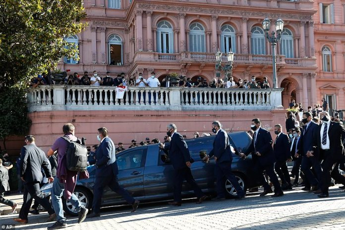 A hearse drives the casket of Diego Maradona to his final resting place after lying in state at the presidential palace in Buenos Aires