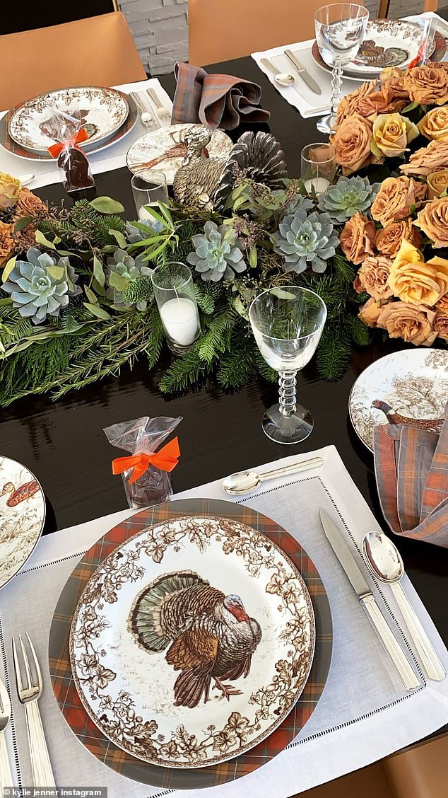 Gobble gobble: Yet more images showed turkey-themed place settings at a lavishly decorated table, presumably for a family lunch