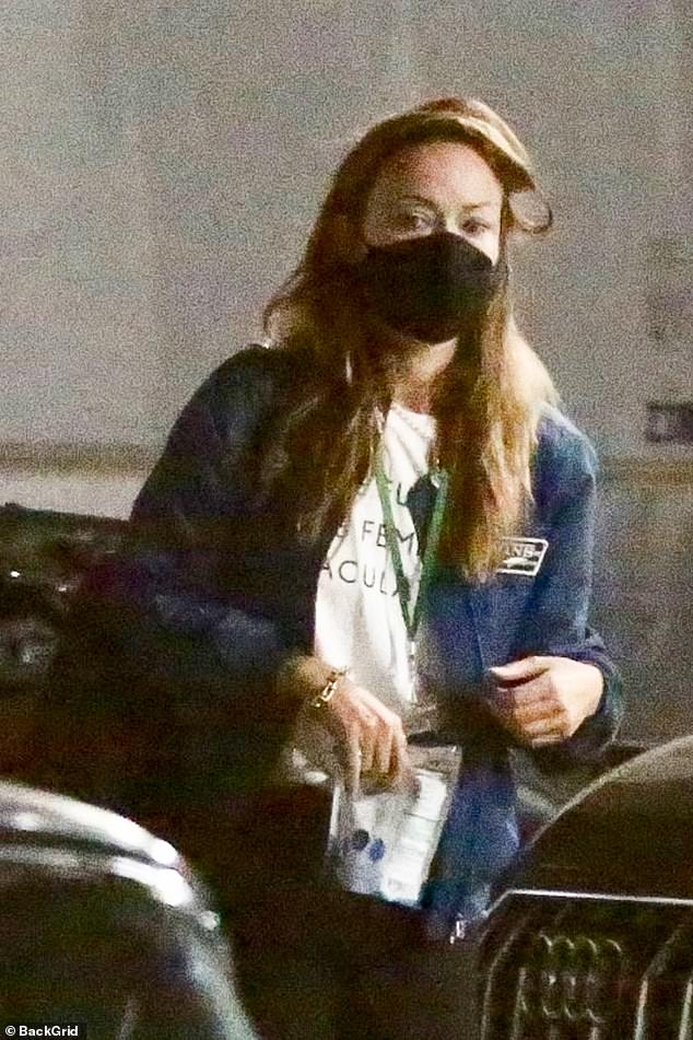 Olivia's look:Wilde also stayed safe amid the global pandemic, wearing a matching black face mask covering her mouth and nose