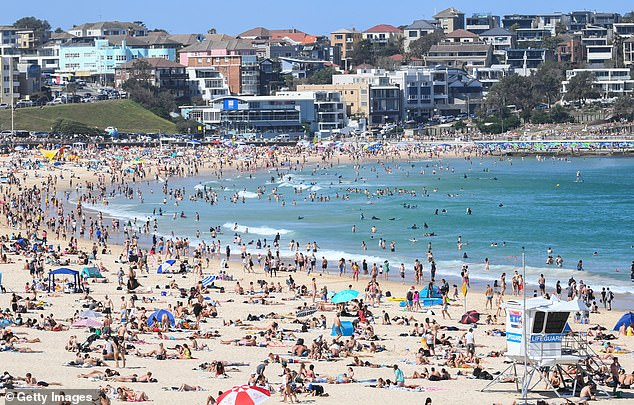 About 400,000 Aussies - including businessmen, tourists and expats - have returned Down Under since March. Pictured: Bondi Beach as busy as ever despite the tourist ban