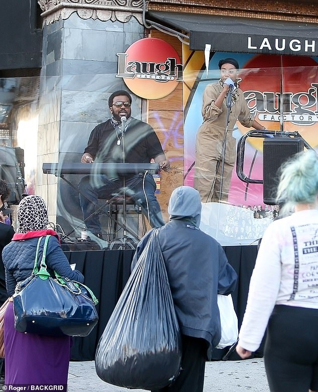 Just for laughs: Both members of the A-list couple joined fellow entertainers at the Laugh Factory in Los Angeles to perform and hand out meals