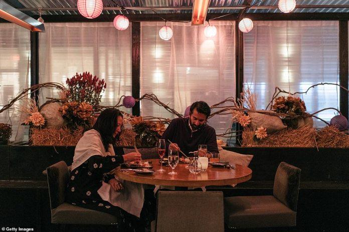 New York, New York: A couple enjoys dinner on Thanksgiving evening in New York City