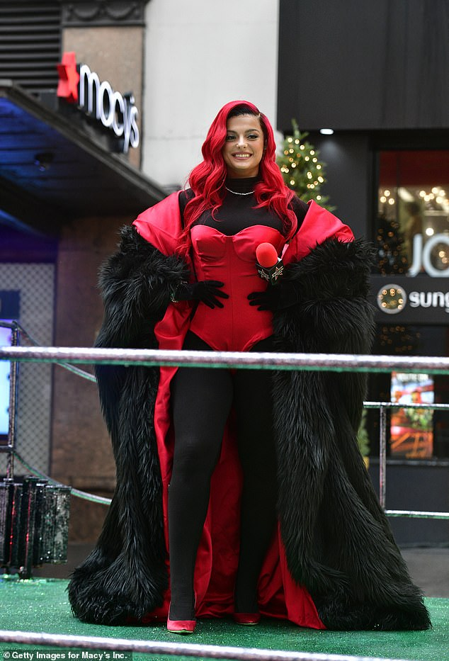 Red hot:Bebe Rexha put on a showstopping display in a bold scarlet ensemble as she performed at the Macy's Thanksgiving Day Parade on Thursday