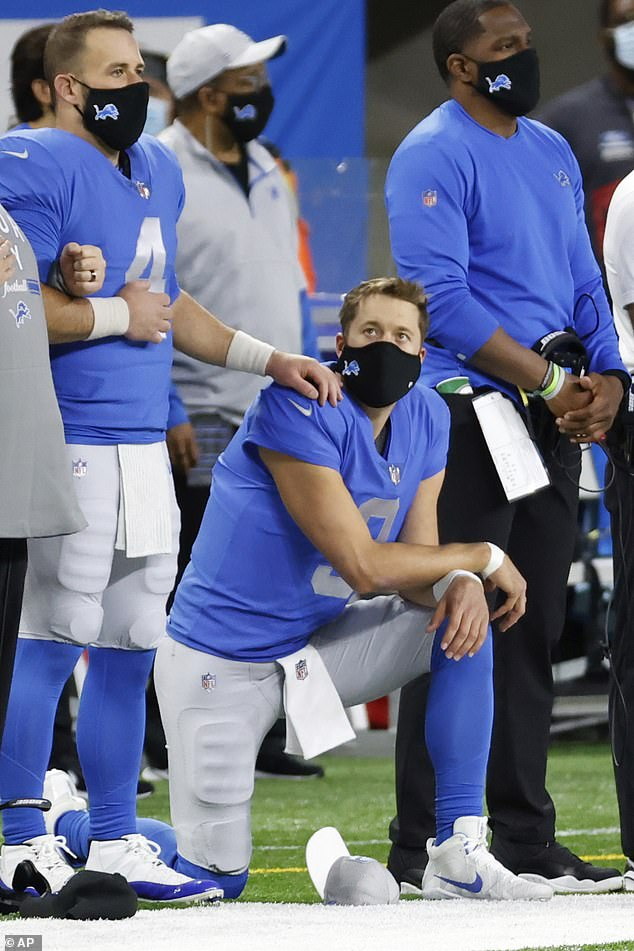 Detroit Lions quarterback Matthew Stafford, number nine, kneels during the national anthem prior to an NFL football game against the Houston Texans yesterday in Detroit