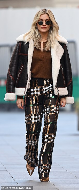 Wrapped up: The Pussycat Doll singer showcased her signature style in a pair of sequin plaid flares, which she teamed with a warm brown wool jumper