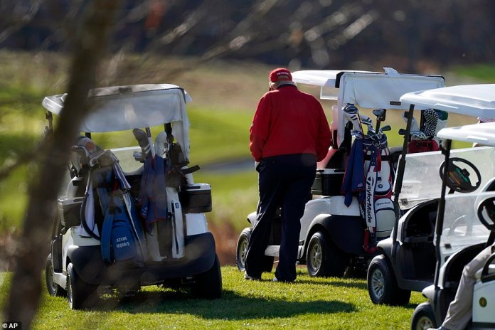 President Trump walks back to his golf cart