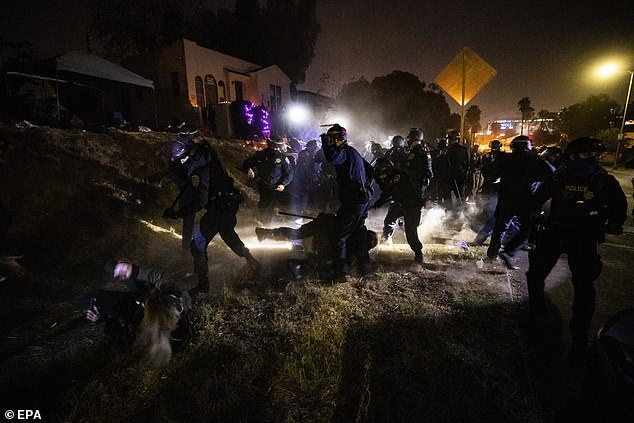 CHP officers, many wearing riot gear, apprehend activists during the demonstration in El Sereno last night