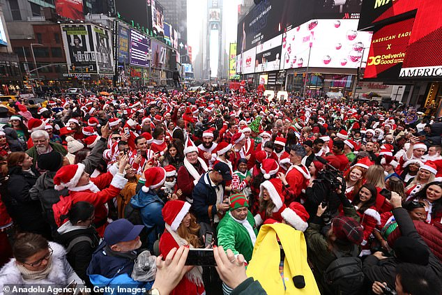 The New York City SantaCon has been cancelled due to the coronavirus pandemic. It is pictured above in 2019 as hundreds of revelers took to Times Square