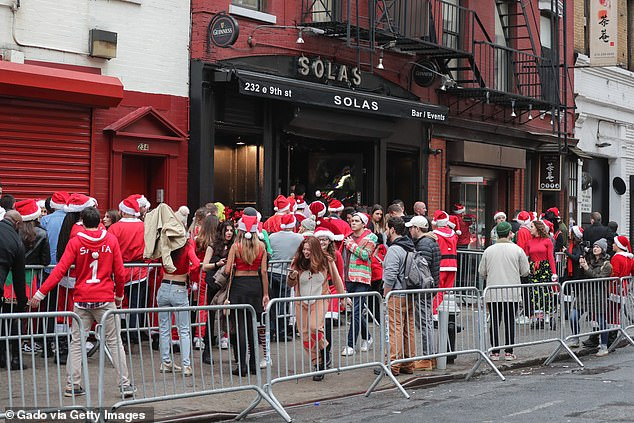 Thousands of people descend on NYC to take on the pub crawl for charity
