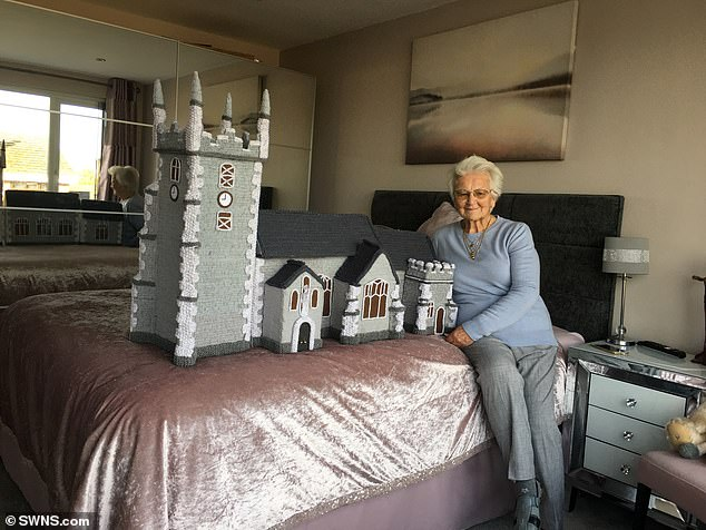 Margaret Seaman, 91, from Caister-on-Sea, near Great Yarmouth, in Norfolk, knitted a woolly version of St Mary Magdalene Church, where members of the Royal Family typically attend Christmas services on the Sandringham Estate (pictured with her masterpiece)
