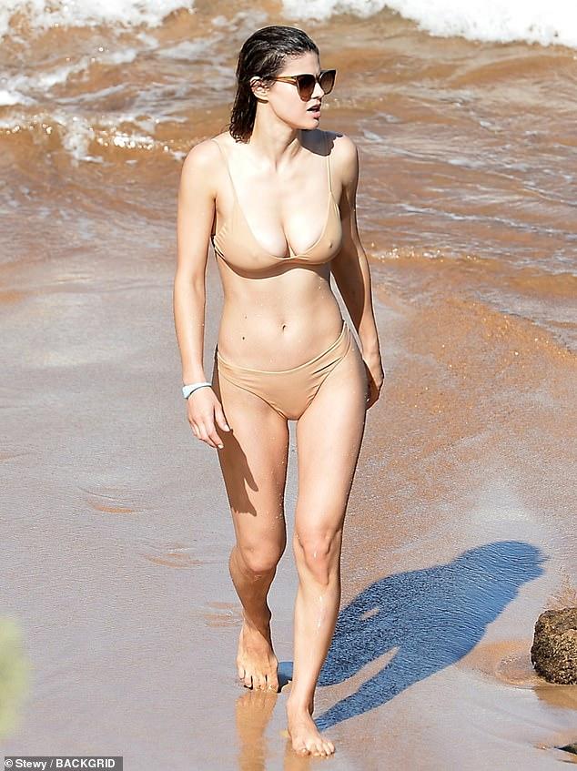 Alexandra Daddario stuns in a beige bikini at the beach with her costar Steve Zahn