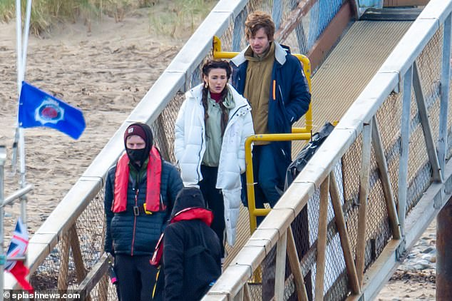 Filming fun: Michelle Keegan was spotted shooting scenes for the third series of Brassic on a dock in North Wales on Friday. Pictured with co-star Damien Molony