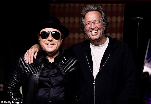 Clapton - who is the only person to have been inducted into the Rock and Roll Hall of Fame three times - recorded the song but it was written by Morrison.  The pair are pictured in London in 2009