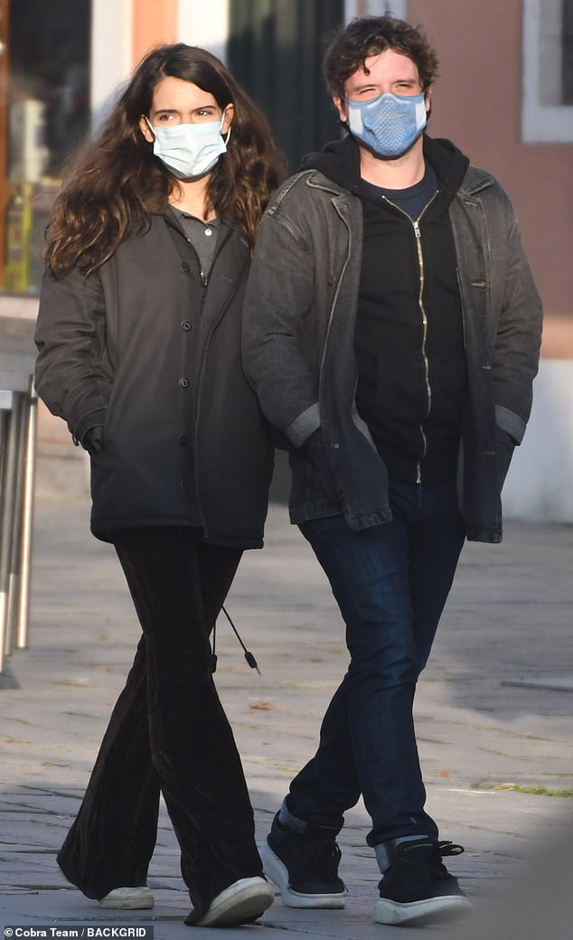 Staying safe: The couple wore face masks as they strolled after lunch on the streets of Venice