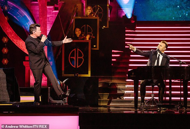 Christmas cheers: Rick Astley and Gary seem to be having fun as they serenade each other