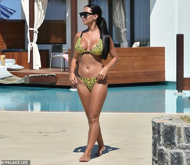 Sizzling!Yazmin Oukhellou looked nothing short of sensational as she spent time relaxing beside the pool and catching some rays during her trip