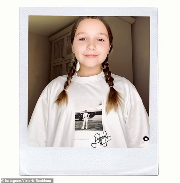Cute:Little Harper supported her mum as she looked adorable in the t-shirt with her hair worn in pretty plaits - the t-shirt was designed in a collaboration between VB and EJAF