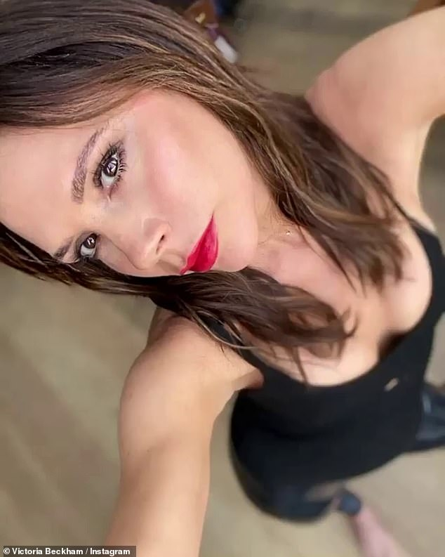 Lady in red:Victoria Beckham decided to shake things up on Saturday as she opted to sport a 'rare red lip' in a glam Instagram snap to promote her make-up range