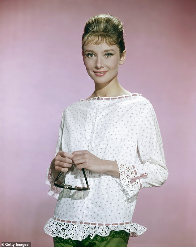 Not amused:Ray also described screen legend Audrey Hepburn flirting with him during their interview - a story which left his wife, Dianne Martin, making a vomiting gesture as he retold it during the interview. Audrey is pictured in 1963
