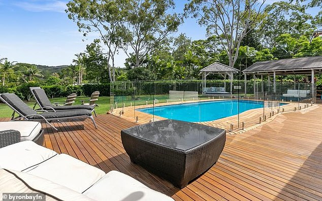 Picturesque: The four-bedroom home (pictured) boasts a pool, a renovated bungalow and lush tropical gardens