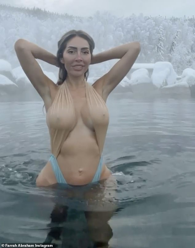 Steamy: Farrah Abraham, 29, stripped down to a striking monokini as she warmed up in a hot spring in a video posted to Instagram on Friday from her trip to Alaska