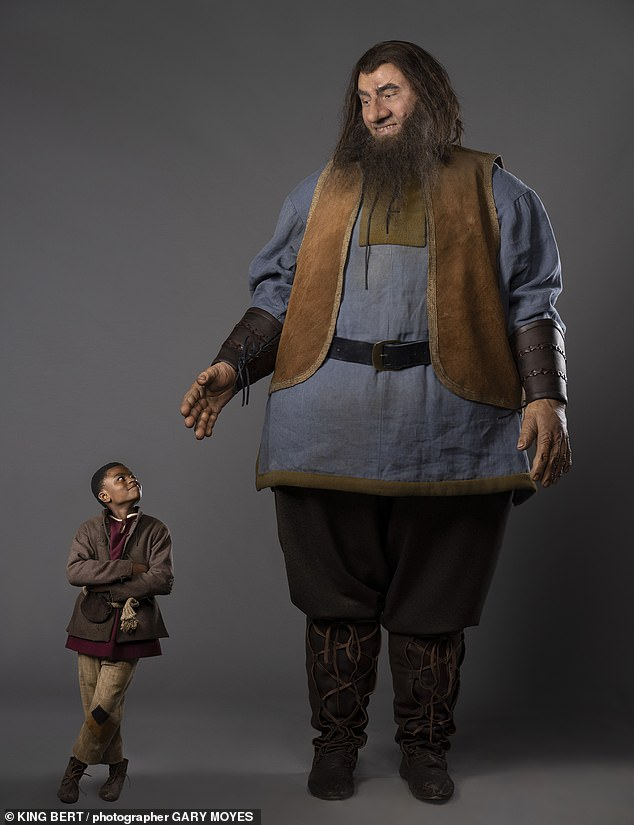 He's huge! In snaps from the show, which will air this Christmas, David towered over Jack who is played by Eddie Karanja