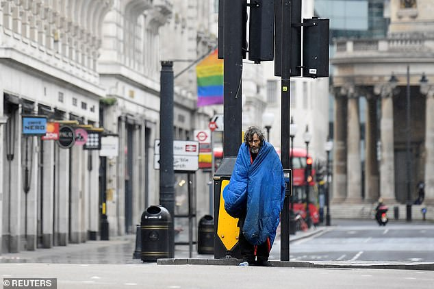 Homeless charities said several households were 'severely affected' by the coronavirus crisis - even before the peak of Covid reached.  Pictured: A homeless man in London in April