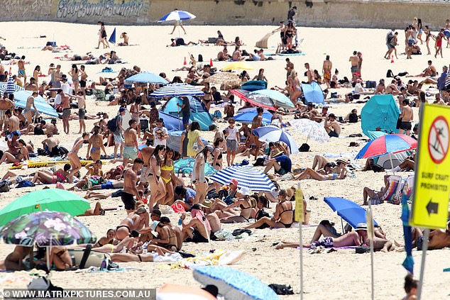 Life is almost back to normal in Australia, with only a handful of restrictions in place (Photo: Sydneysiders enjoying the hot weather at Bondi Beach during a heat wave on Saturday)