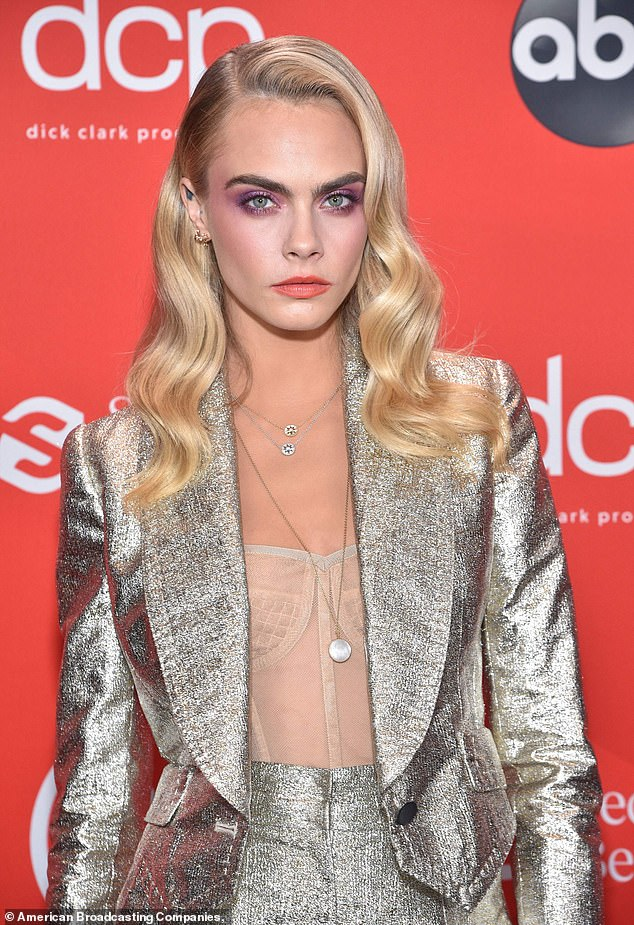 Show: Six days before the alleged bash, Cara, 28, attended the American Music Awards in Los Angeles ¿ despite the long-imposed 14-day quarantine order for travellers landing in the UK