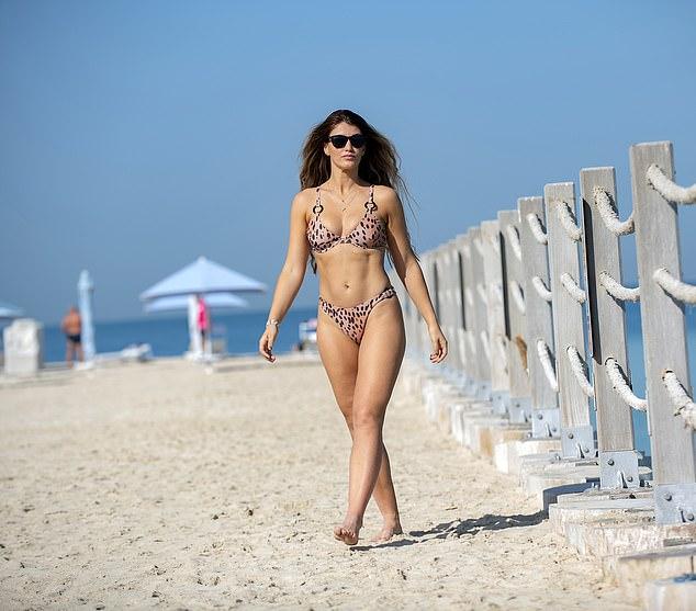 Amy Willerton looks sensational in a skimpy patterned bikini during Dubai beach break