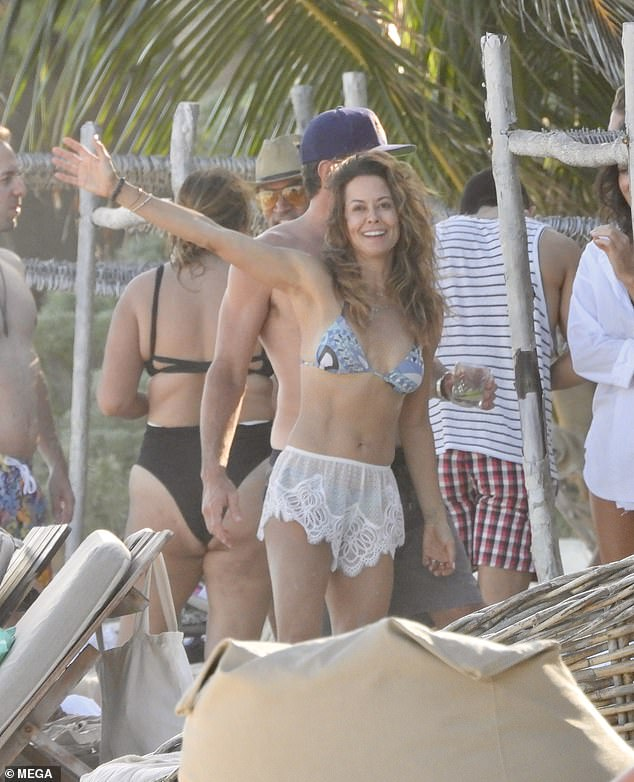 Sun Seeker: Brooke Burke was in full moon shock as she posed while on vacation in Mexico with boyfriend Scott Rigsby