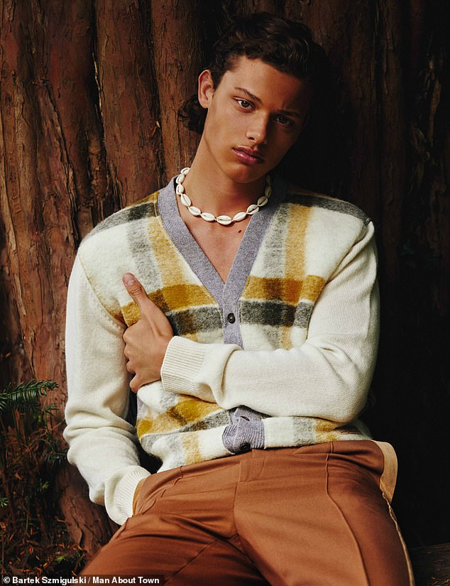 Looking good: In one image Bobby gives the shoot an androgynous flourish by sporting a highly distinctive shell necklace - provided by stylist Kieran Fenney