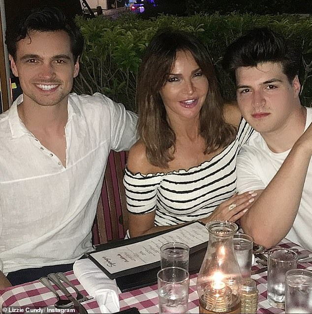 Embarrassing: Lizzie admits she often has her sons Josh, 25, and James, 21, putting their heads in their hands with her antics