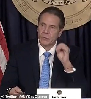 Gov Cuomo sparked uproar on Twitter by playing classic Christmas music and singing during his coronavirus briefing on Monday where he declared: 'COVID is the Grinch'