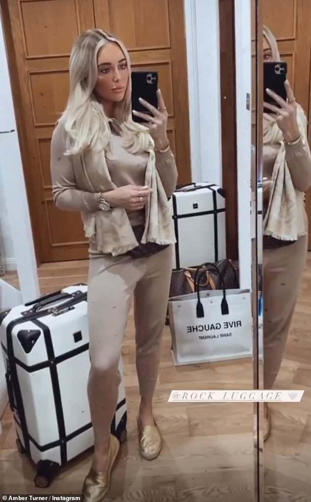 Work it:Amber displayed her toned figure in a tiny beige tracksuit with a zip-up top and high-waisted bottoms