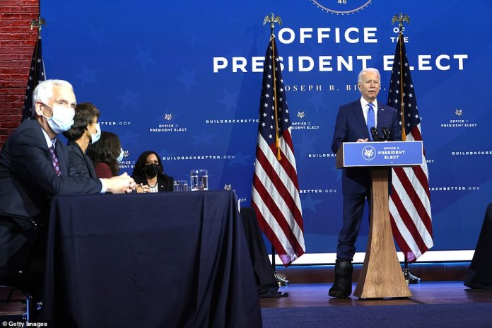 Stand-up meeting: Biden spoke from behind a lectern, but sat down after