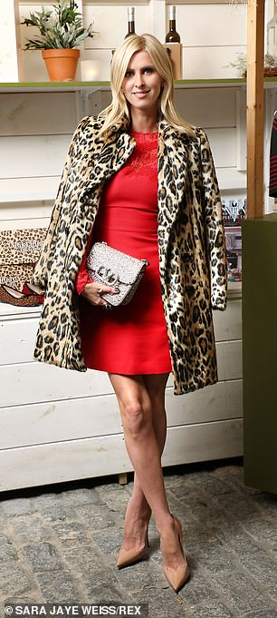 She added a little sparkle with a glittery silver clutch and draped a leopard print coat across her shoulders