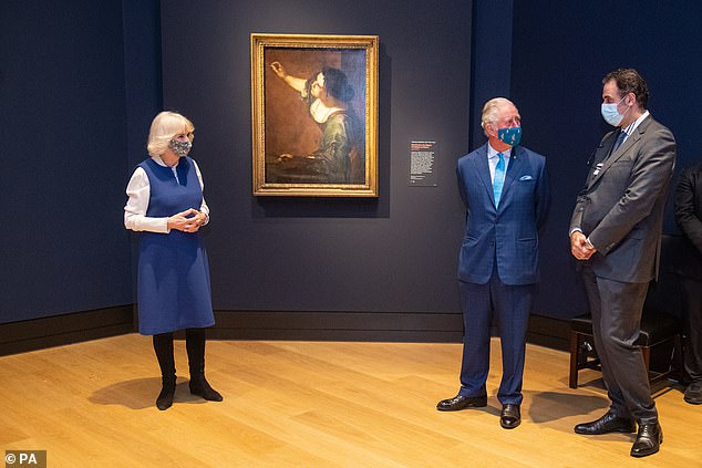 The Prince of Wales, 72, and the Duchess of Cornwall (pictured with National Gallery director Dr Gabriele Finaldi, right), 73, covered their faces as they visited the London landmark for a visit tonight.