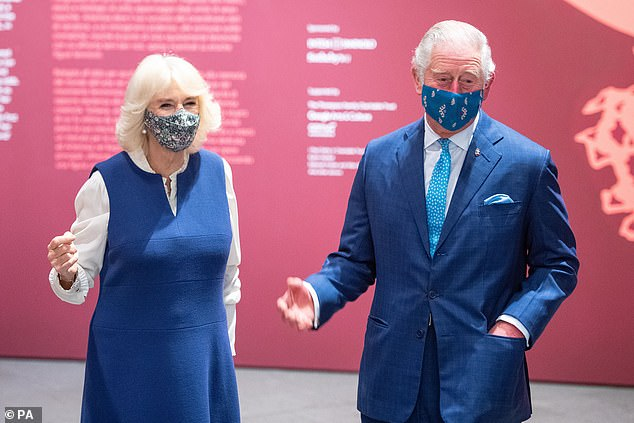Camilla opted for a bright blue dress for the occasion, while Prince Charles wore a matching elegant royal blue suit (pictured together)