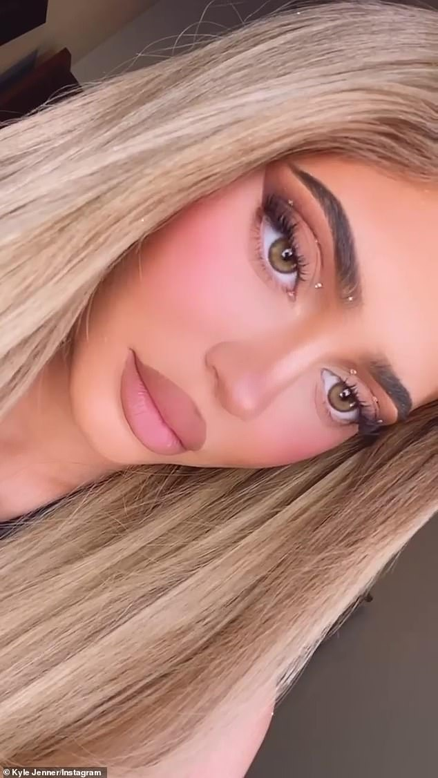 Making it happen:Kylie, who recently released a Grinch-themed beauty collection for the Christmas season, posted a couple of new close-ups of her face as well