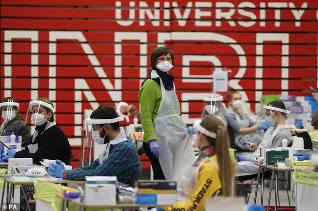 Students are currently undergoing tests to allow them to return home this Christmas. They will take the swabs between November 30 and December 6. Pictured:People carry out asymptomatic testing using lateral flow antigen at a test centre at Edinburgh University ahead of students being allowed to travel home for the Christmas holidays